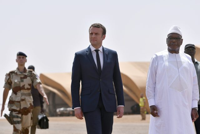 French President Emmanuel Macron reviews troops