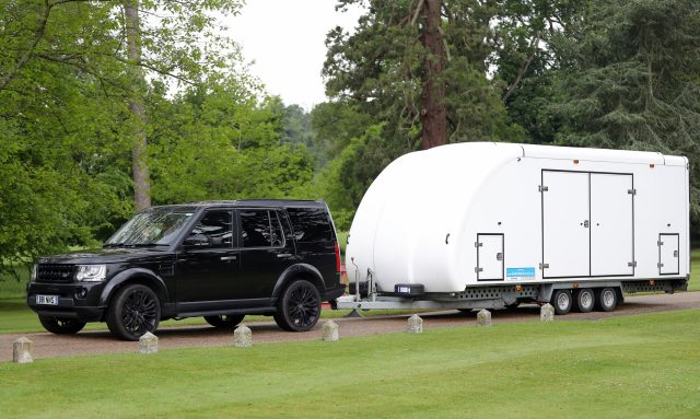 A car towing a trailer leaves the Englefield Estate