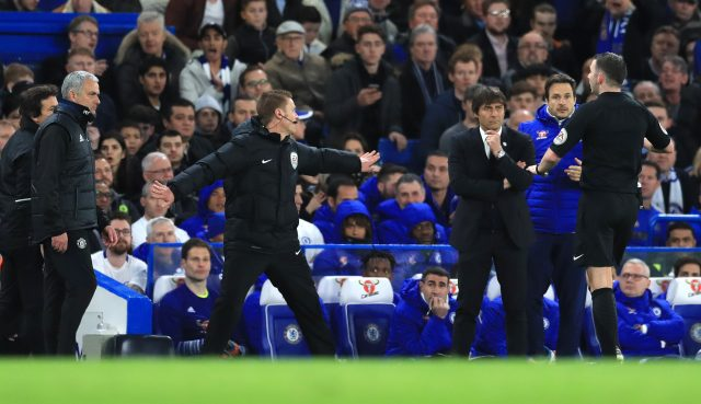 Referee Michael Oliver speaks to Jose Mourinho and Antonio Conte