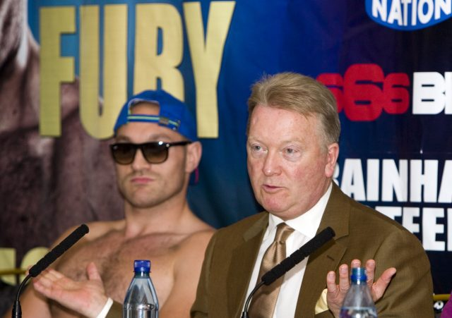 Tyson Fury (left) with promoter Frank Warren, who hopes for some intervention (Simon Cooper/PA )