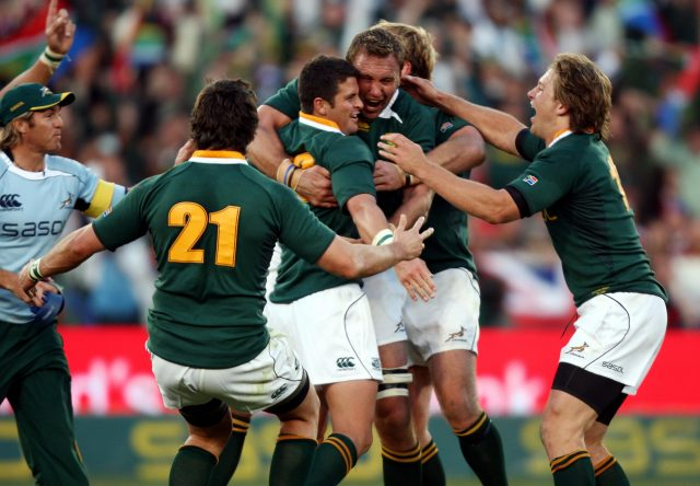 South Africa's Morne Steyn is mobbed by his team-mates after kicking the winning penalty