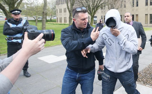 Tommy Robinson films an unidentified man arriving at Huddersfield Magistrates Court in April