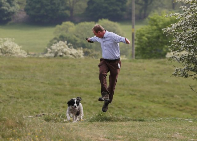 The Lib Dem leader had an energetic walkabout with his dog Jasper in Cumbria (Yui Mok/PA)
