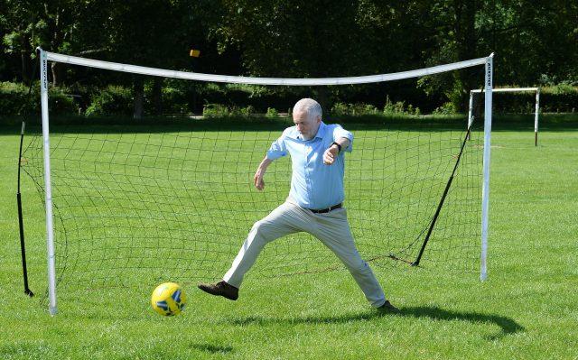 A penalty kick from a child gets past Mr Corbyn (John Stillwell/PA)