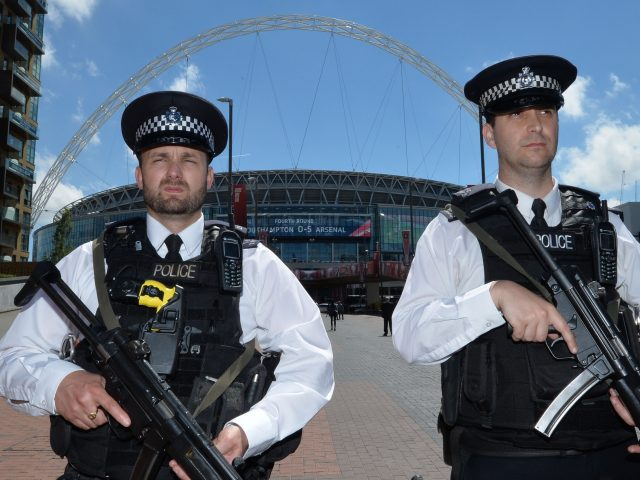 Armed police officers outside Wembley Stadium ahead of the FA Cup Final