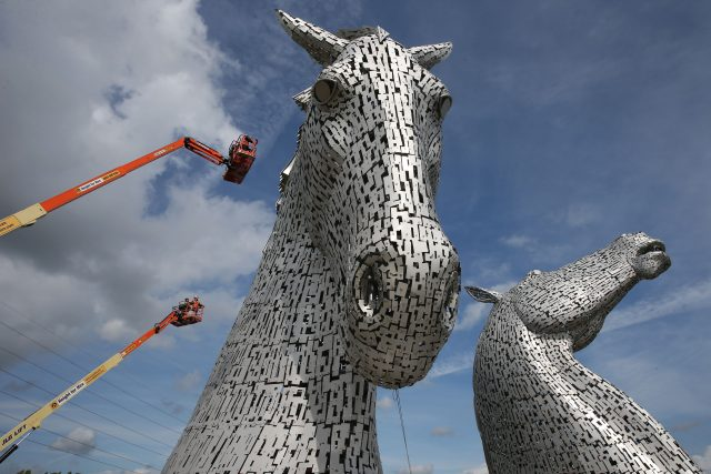 Rope Access Technicians Andrew Pennycuick (bottom), Paul Smith (centre) and John Benson carry out the first health check on the Kelpies in Falkirk as they approach their third birthday