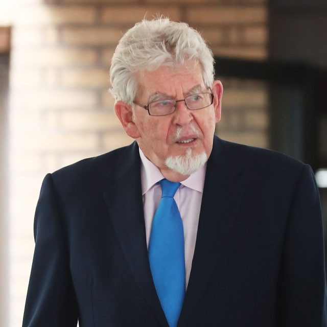 Rolf Harris leaves court after prosecutors said they will not seek a second retrial (Gareth Fuller/PA)