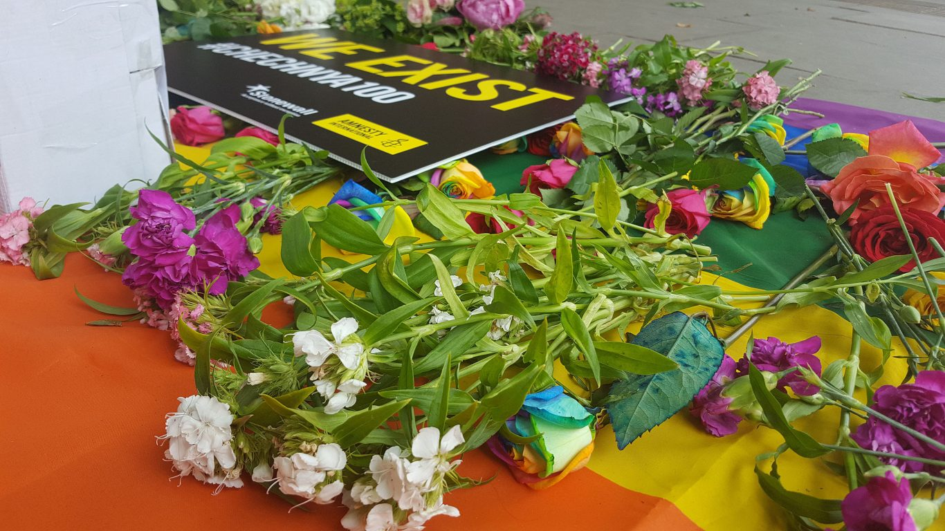 Flowers laid on a flag outside the Russian embassy during the protest (Dominic Harris/PA)