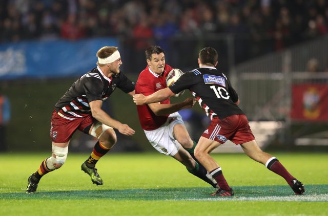 Johnny Sexton (centre) is tackled by Provincial Union XV's Bryn Gatland (David Davies/PA)