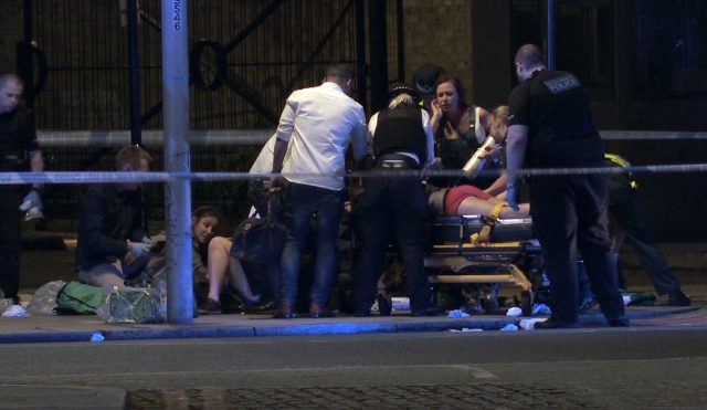 Screengrab taken from video footage of some of the wounded being treated by ambulance staff (PA)