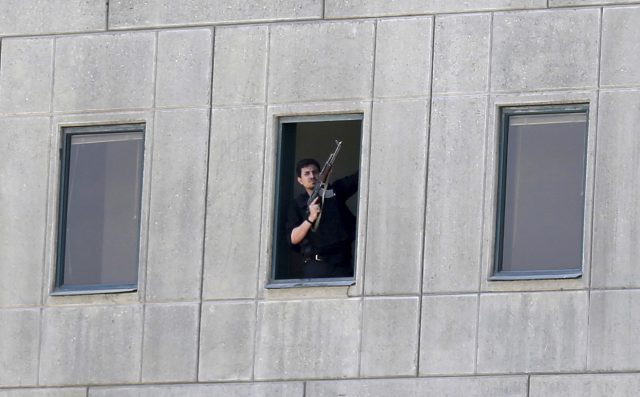 The moment armed terrorists storm Iran's parliament
