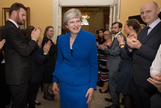 Top two aides to British PM May quits