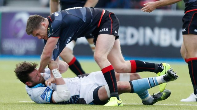 Ryan Wilson clashes with Saracens' Owen Farrell while playing for Glasgow