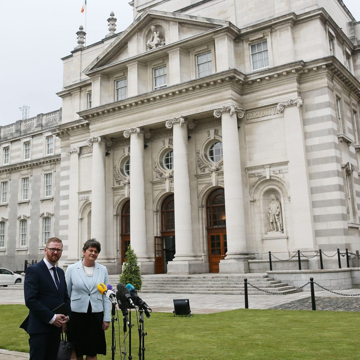DUP leader Arlene Foster and DUP's Simon Hamilton outside Government Buildings in Dublin (Brian Lawless/PA)