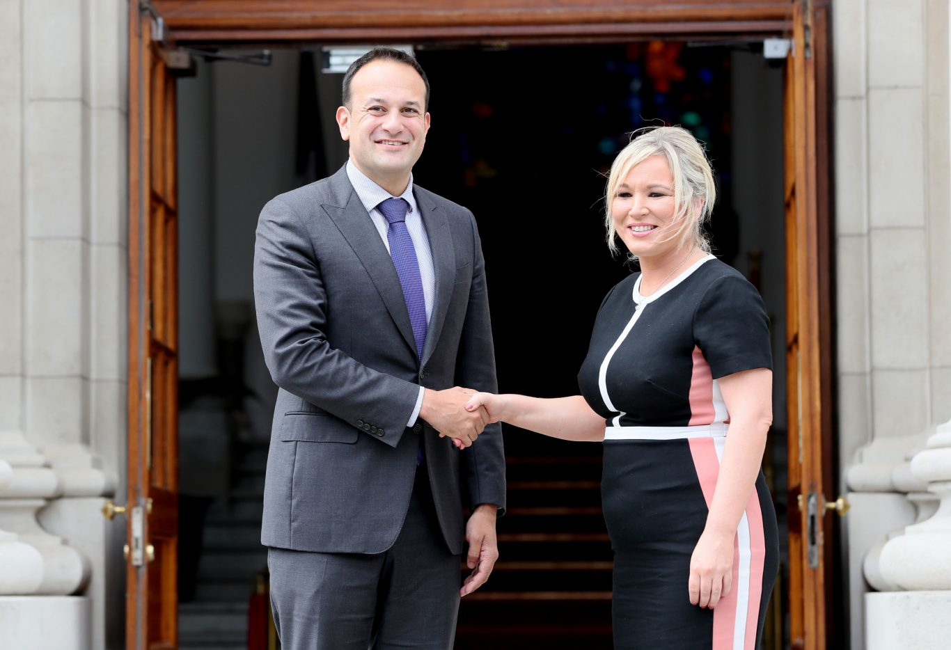 Taoiseach Leo Varadkar welcomes Sinn Fein's Northern Ireland leader Michelle O'Neill to Government Buildings in Dublin (Brian Lawless/PA)