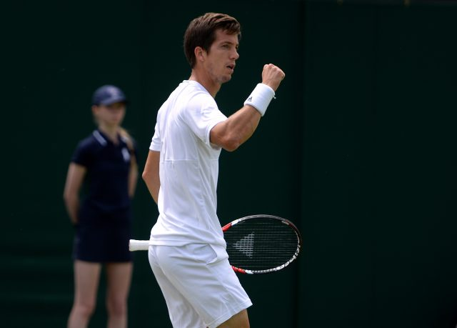 Aljaz Bedene celebrates against Richard Gasquet on day Two of the Wimbledon Championships at the All England Lawn Tennis and Croquet Club, Wimbledon.