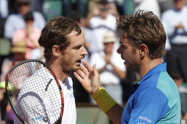 Switzerland's Stan Wawrinka, right, talks to Britain's Andy Murray after their semifinal match of the French Open tennis tournament at the Roland Garros stadium, Friday, June 9, 2017 in Paris. Wawrinka beat top-ranked Andy Murray 6-7 (6), 6-3, 5-7, 7-6 (3), 6-1 to reach the French Open final. (AP Photo/Michel Euler)