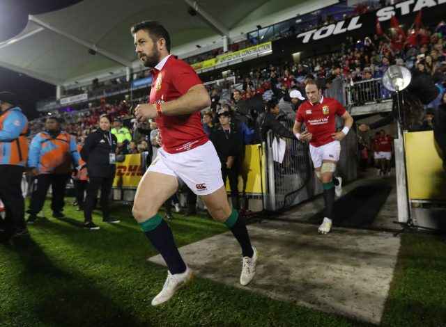 Greig Laidlaw runs out on to the field ahead of a Lions match