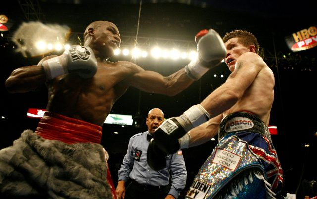 Floyd Mayweather aims a punch at Rocky Hatton during their 2007 bout