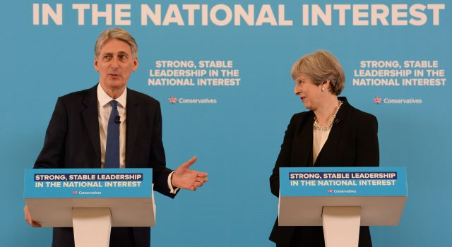 Theresa May and  Philip Hammond during a general election campaign event (Stefan Rousseau/PA)