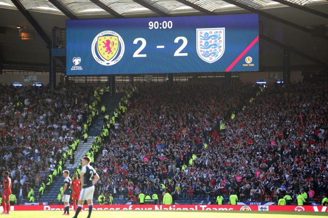 The Hampden Park scoreboard shows Scotland 2 England 2