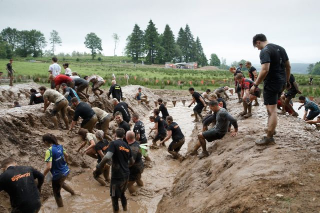 Participants take part in a Tough Mudder event race at Drumlanrig Castle, Thornhill in Scotland