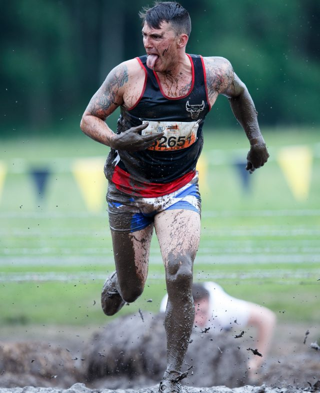 A man takes part in a Tough Mudder event