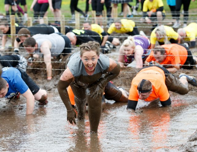 Participants take part in a Tough Mudder event