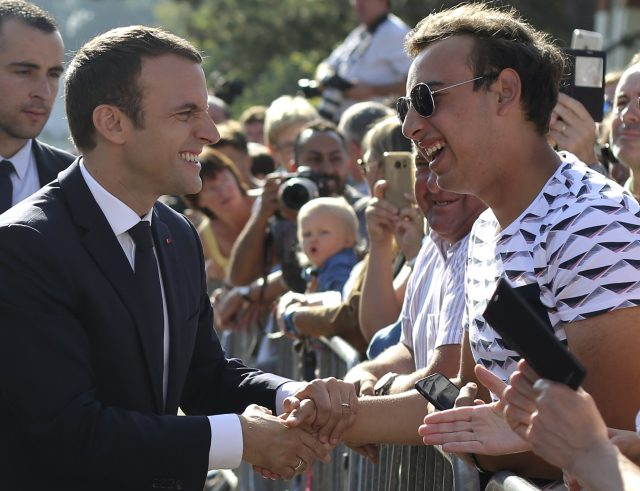 Emmanuel Macron meets people after voting in the final round of parliamentary elections