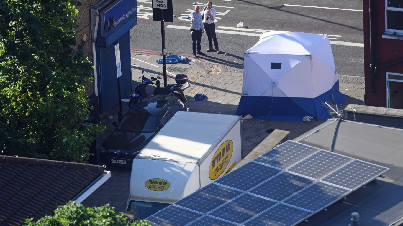 A forensic tent stands next to a van in Finsbury Park (Victoria Jones/PA)