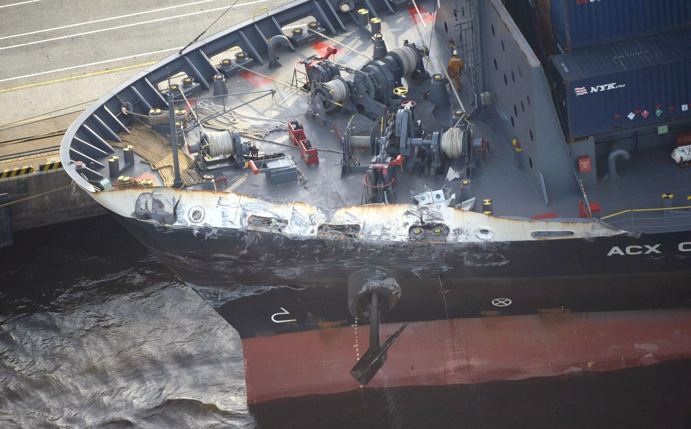 The container ship ACX Crystal with its left bow dented and scraped after colliding with the USS Fitzgerald in the waters off the Izu Peninsula (Hitoshi Takano/Kyodo News via AP)