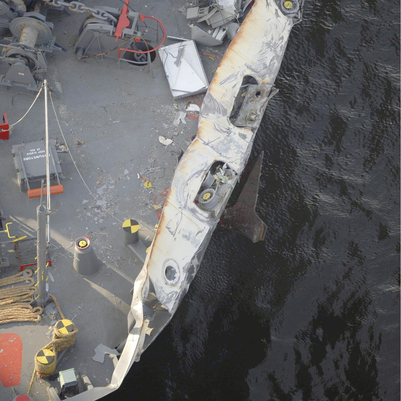 The container ship ACX Crystal with its left bow dented and scraped after colliding with the USS Fitzgerald (Hitoshi Takano/Kyodo News via AP)