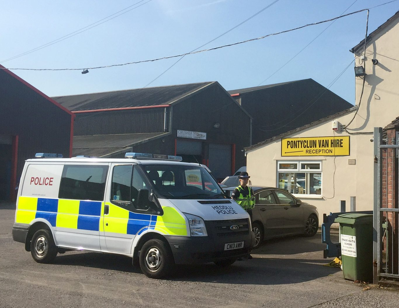 A police van outside Pontyclun Van Hire in Pontyclun, Mid Glamorgan. A van hired from the company was found in Finsbury Park (Claire Hayhurst/PA)