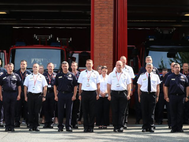 Firefighters and staff observe a minute's silence at Manchester Community Fire Station (Peter Byrne/PA)