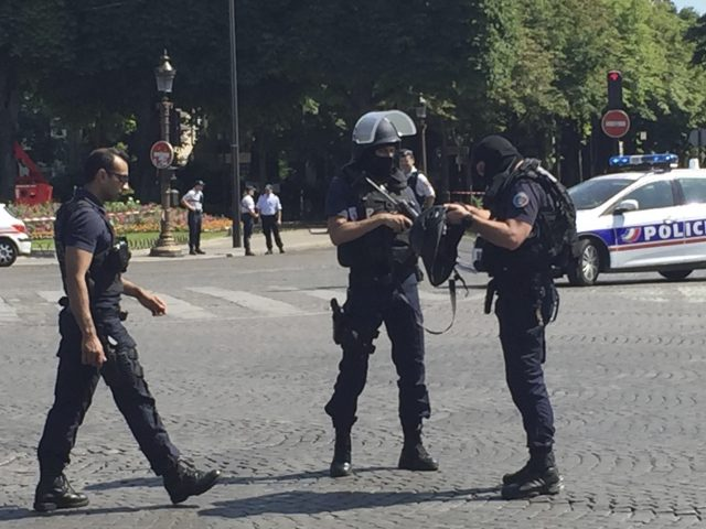 Police at the scene (Bertrand Combaldieu/AP)