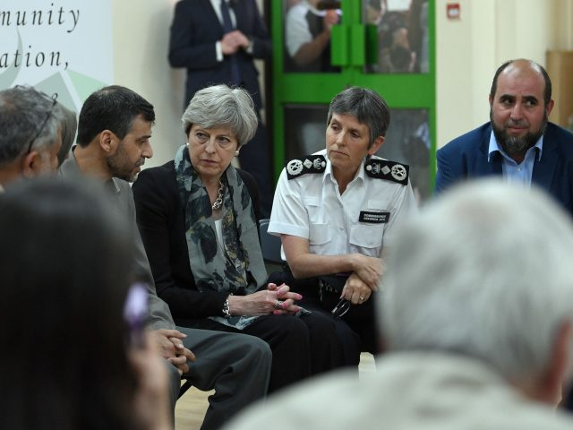 Mrs May at Finsbury Park Mosque (Stefan Rousseau/PA)