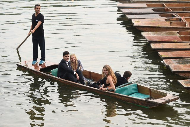 Students enjoy a punt ride along the River Cam after attending a May Ball at Cambridge University