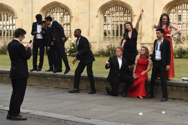 Students pose for photos outside Kings College at Cambridge University