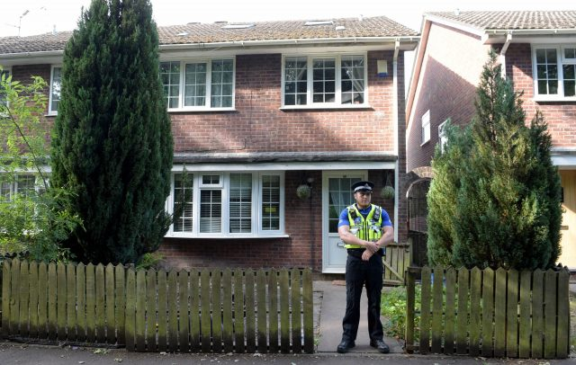 A police community support officer outside a residence in Cardiff
