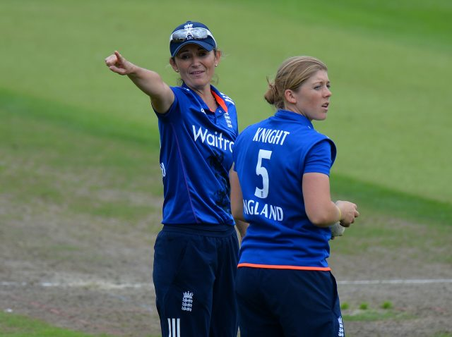 Heather Knight and Charlotte Edwards in a discussion on the field