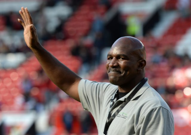Evander Holyfield waves