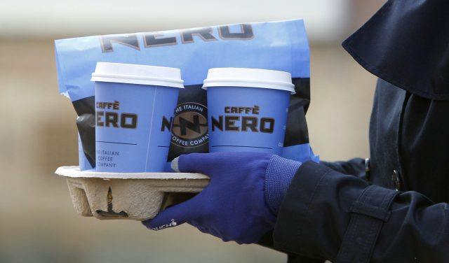 A person carries Caffe Nero goods