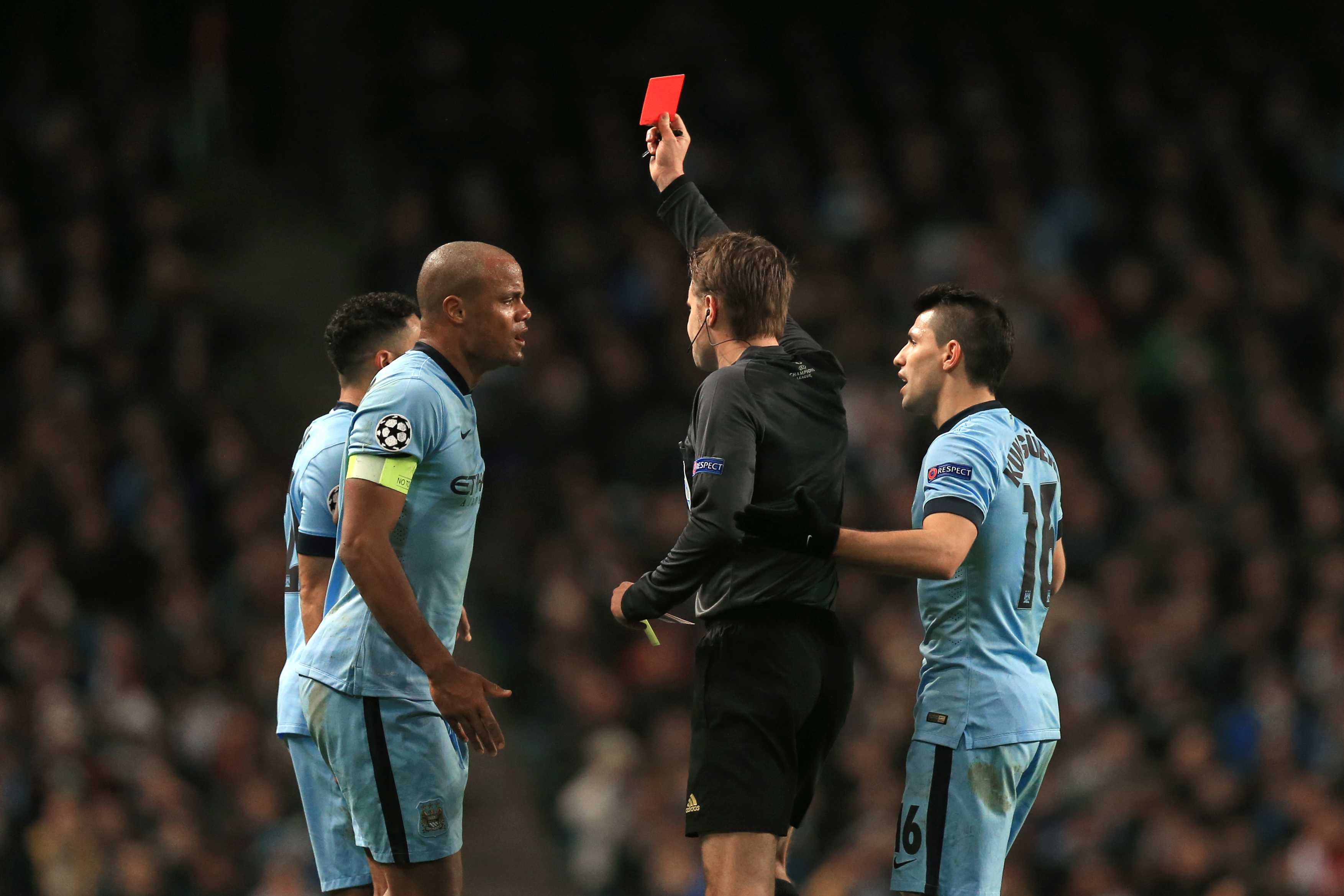 Man City's Gael Clichy, left, is shown the red card by ref Felix Brych.