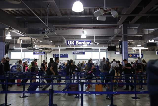 A queue at UK border control in Luton Airport