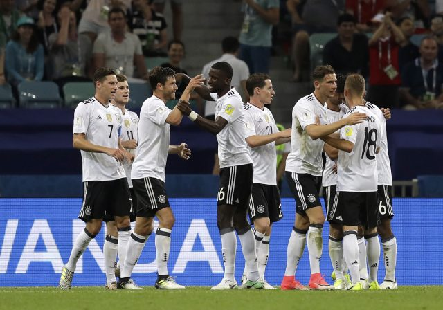 Germany players celebrate after scoring their third goal