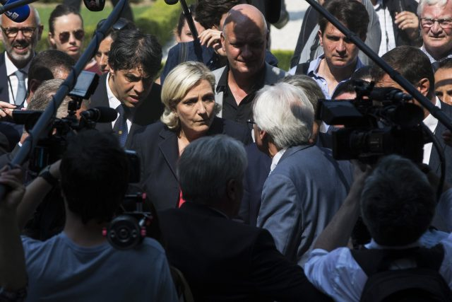 French right-wing leader Le Pen charged in funding scandal