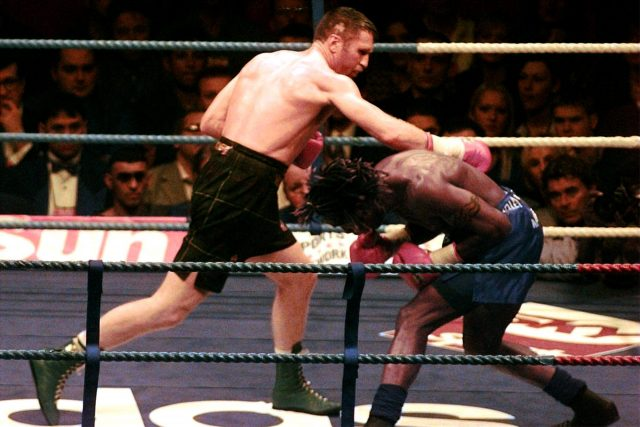Steve Collins and Nigel Benn fight for the WBO World super middleweight title in 1996