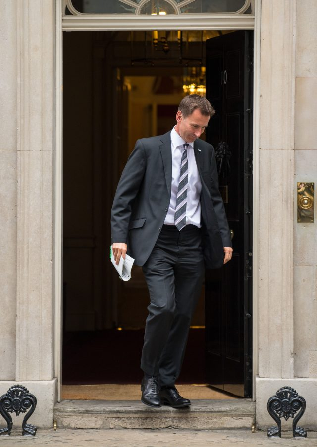 Health Secretary Jeremy Hunt leaves 10 Downing Street (PA)
