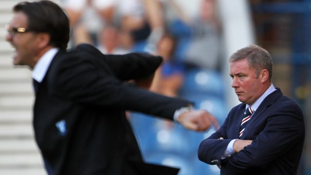 A glum Ally McCoist looks on as Malmo manager Rikard Norling celebrates