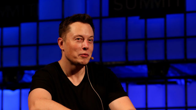 Musk said he is working round the clock to help get through the backlog of cars Tesla has to produce (Brian Lawless/PA)